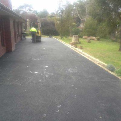 Asphalt paving driveway residential.